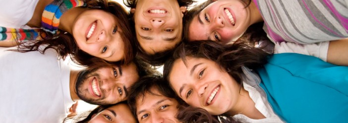 group of happy friends smiling with heads together