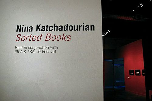Nina Katchadourian's visual art exhibit of photographs of books she has arranged, 1993-present, curated by Mack McFarland, at the Pacific Northwest College of Art (PNCA) in conjunction with the 2010 Time-Based Art Festival in Portland, Oregon. Photo taken 9/16/10 by Sara Regan. All rights reserved, PICA (Portland Institute for Contemporary Art)