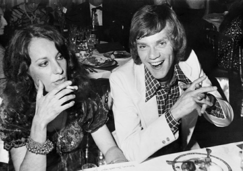 British actor Malcolm Mcdowell and French actress Bernadette Lafont attend an official dinner during the 26th Cannes Film Festival in Cannes, on May 1973. / AFP PHOTO / Ralph Gatti