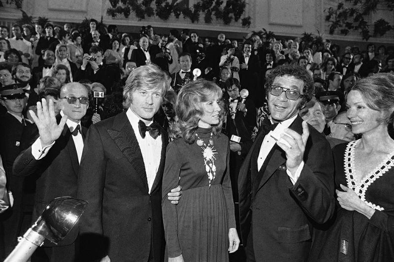 "FILE - In this May 7, 1972 file photo, from left, actor Robert Redford and wife Lola, and director Sydney Pollack and wife, Claire Griswold arrive at Festival Palace for the presentation of American film ""Jeremiah Johnson"" in Cannes, France. The Cannes Film Festival officially gets underway on Wednesday, May 11, 2016 and as usual it's set to be one of the most dazzling events in the European entertainment calendar. The festival, in its 69th year, brings a mix of Hollywood A-listers and world cinema auteurs to the French Riviera. (AP Photo/Jean-Jacques Levy, File)"