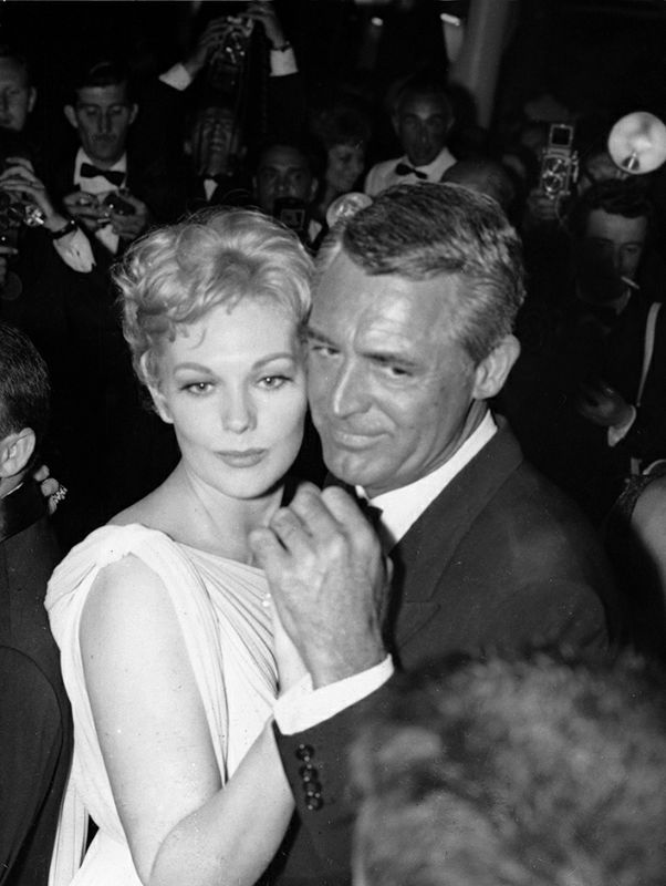 "FILE - In this May 13, 1959 file photo, American actress Kim Novak dances with Cary Grant after the presentation of the American film entry ""Middle of the Night"", at a U.S. reception at the Cannes Film Festival. The Cannes Film Festival officially gets underway on Wednesday, May 11, 2016 and as usual it's set to be one of the most dazzling events in the European entertainment calendar. The festival, in its 69th year, brings a mix of Hollywood A-listers and world cinema auteurs to the French Riviera. (AP Photo, File)"