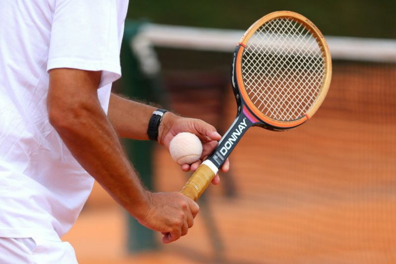wooden-racket-and-white-tennis-ball-mccvt-e1430230184863